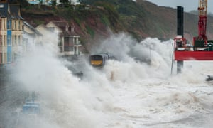 Stormy weather brings waves crashing over trains at Dawlish,