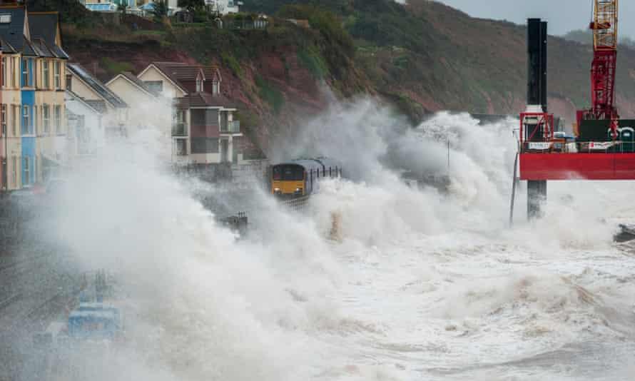 Stormy weather brings waves crashing over trains at Dawlish,