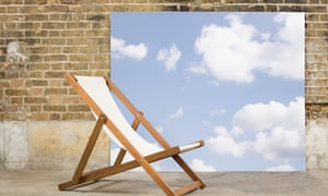 Deck chair with sky backdrop