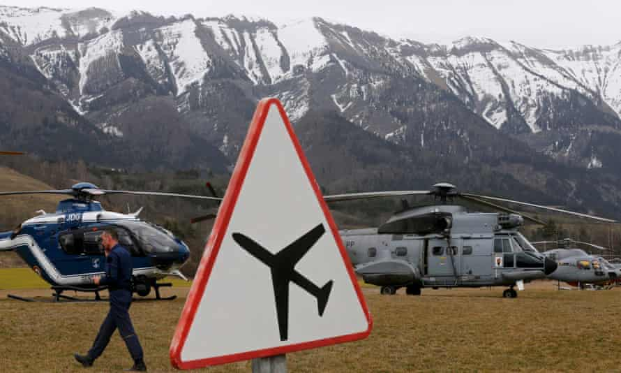 Rescue helicopters mount an operation near to the crash site of an Airbus A320 in the French Alps.