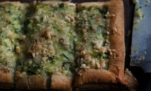 A rectangular leek, courgette and Caerphilly tart, sliced into three