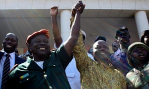 Chief of State Major of Army of Guinea-Bissau Antonio Indjai (L) celebrates the victory of the candidate of PAIGC party to Presidency Jose Mario Vaz (R) after being declared winner of the elections, in Bissau, Guinea-Bissau, 20 May 2014. Jose Mario Vaz won the elections against independent candidate Nuno Gomes Nabiam according to provisional results announced by the National Elections Commission.