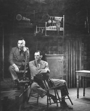 1949:  Director Elia Kazan and Arthur Miller sitting on Broadway set
