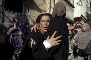 Women mourn during the funeral of the boys who got killed by an Israeli naval bombardment in the port of Gaza cry during their funeral in Gaza City. Four boys died on the spot during an Israeli naval bombardment in the port of Gaza, a fifth boy died shortly after the attack in hospital. Israel stepped up its attacks on 16 July by bombing the homes of Hamas leaders after the Islamist movement rejected a truce proposal and instead launched dozens more rockets into Israel