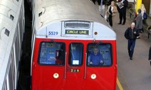 A Circle line train leaves Farringdon station.