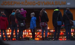 Well-wishers at a memorial in front of the school that is believed to have lost 16 students and two teachers in the crash.