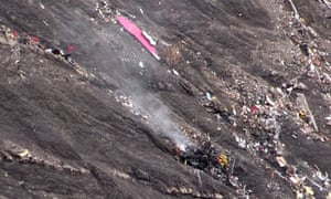 A screengrab from an AFP TV video shows smoke rising from the crash site.