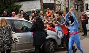 Anti-Ukip protesters surround the Ukip party leader Nigel Farage's car as he leaves the Queen's Head