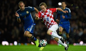 Alen Halilovic of Croatia is challenged by Pablo Zabaleta of Argentina during a friendly at Upton Park.