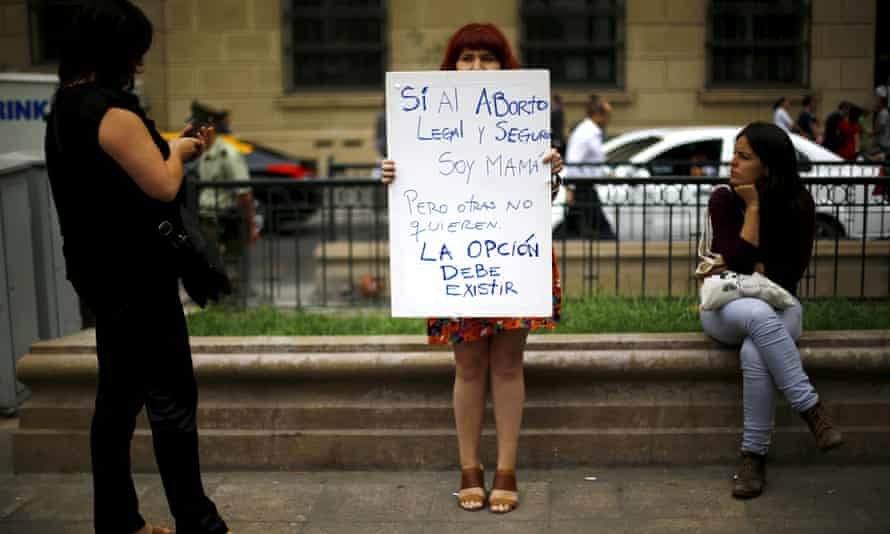 A woman holds up a pro-choice banner in Santiago, Chile, as the government considers a bill to ease the country's complete ban on abortion.
