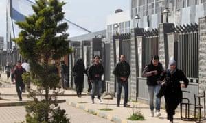 Civilians run  in Homs