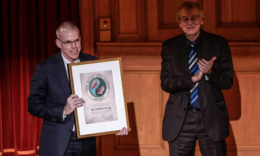 """Bill McKibben (L) representing the organization 350.org of the U.S. receives the Right Livelihood Award from Jakob von Uexkull during the Right Livelihood Award ceremony at the second chamber hall at the Swedish Parliament in Stockholm December 1, 2014. McKibben receives the award for """"mobilizing growing popular support in the USA and around the world for strong action to counter the threat of global climate change."""""""