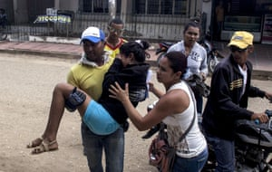 A teenage girl is brought to hospital in Carmen de Bolivar, Colombia, after fainting.