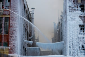 <strong>Frozen</strong><br>While firemen were putting out a fire in Chicago, the water froze and coated everything in ice. Chicago, Illinois, US.