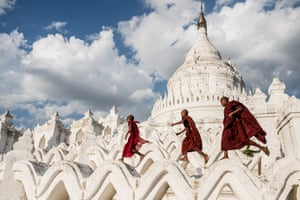 Young Buddhist novices run on Hsinbyume Pagoda after the tourists have left. Photography by Sergio Carbajo Rodriguez, 08530 La Garriga, Barcelona, Spain Photographed at Min Kun, Republic of the Union of Myanmar
