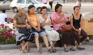 Kyrgyz women having icecreams on a bench in center of Bishkek, Kyrgyzstan on 28 August 2009.