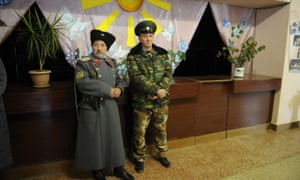 Pro-Russian militants stand guard at a polling station in eastern Ukrainian during controversial leadership elections that Kiev and the west have refused to recognise.