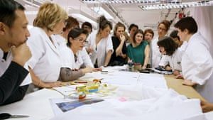 The atelier workers choose a dress from the collection to design.