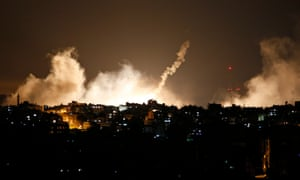 Smoke from flares rises in the sky in Gaza City, in the northern Gaza Strip in July 2014. Amnesty International has accused Palestinian militant organisations of committing war crimes during the Gaza-Israel conflict.