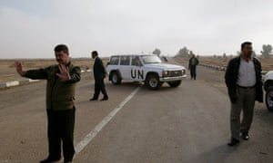 An UNMOVIC vehicle blocks the entrance of  the Al-Muthanna state establishment 40 miles north west of Baghdad after U.N. weapons inspectors entered the complex in 2002. The Al-Muthanna complex was the main production facility for chemical and biological agent production in the 1990's. Previous weapon inspection teams rendered the facility inoperative.