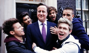 David Cameron stands outside Downing Street with One Direction
