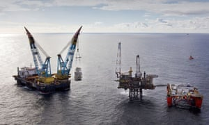 Shell says the cuts and changes to workers' terms are not solely a reaction to the near-halving of the oil price.
