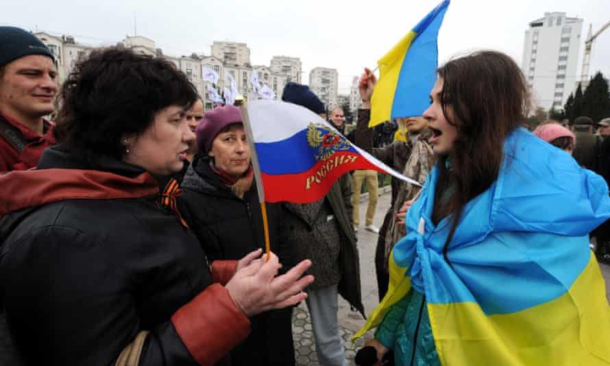 Pro-Russian and pro-Ukrainian activists argue during a rally in Sevastopol, Crimea, in 2014.