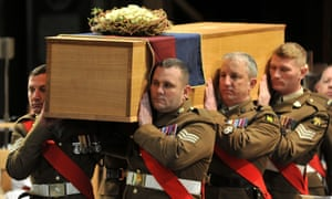 The coffin is carried by the military bearer party during the service for the re-burial of Richard III at Leicester cathedral.