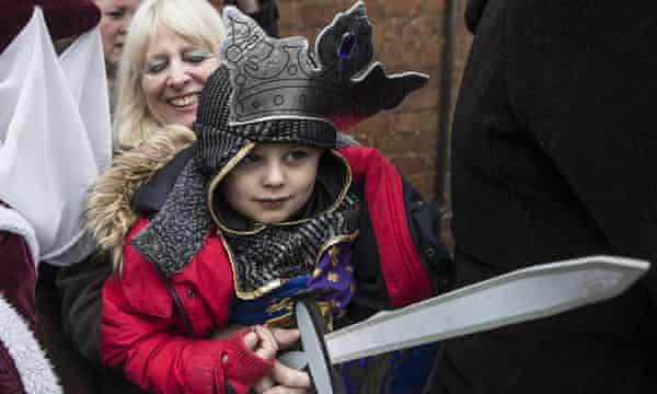 Four-year-old Torin Weston, dressed as Richard III, waits with his grandmother outside Leicester Cathedral.