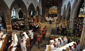 Richard III's coffin is carried by the military bearer party into Leicester Cathedral.