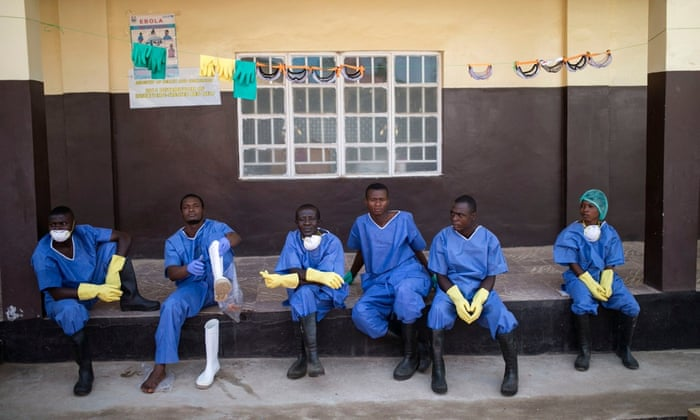 Health workers outside a quarantine zone at a Red Cross facility in the town of Koidu, Sierra Leone in December.