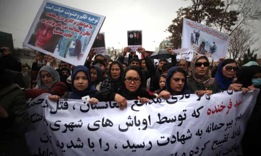 People attend a protest demanding justice for a woman who was beaten to death in Kabul, Afghanistan, March 24, 2015. Farkhunda, 27, was beaten with sticks and stones, thrown from a roof and run over by a car outside a mosque in Kabul on March 19 for allegedly burning a copy of the Koran, police officials said.