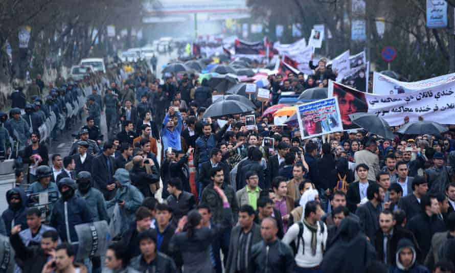 Afghan protesters hold banners as they shout slogans during a rally in front of The Supreme Court in Kabul on March 24, 2015, held to protest the killing of Afghan woman Farkhunda. More than a thousand people protested in the Afghan capital to call for justice after a woman was brutally killed by a mob who falsely accused her of burning a copy of the Koran.