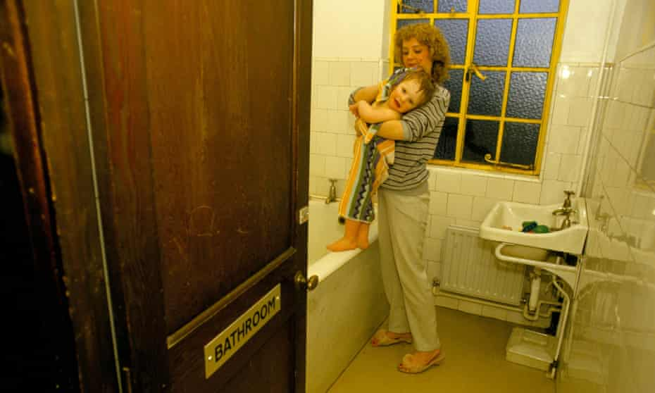 homeless woman and child in bathroom
