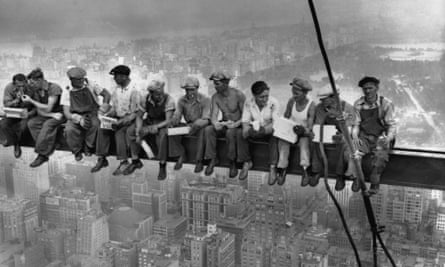 Construction workers eat lunch atop a steel beam, 800ft above ground, at the building site of the RCA Building in Rockefeller Center. Photograph: Charles C Ebbets/Bettmann/Corbis