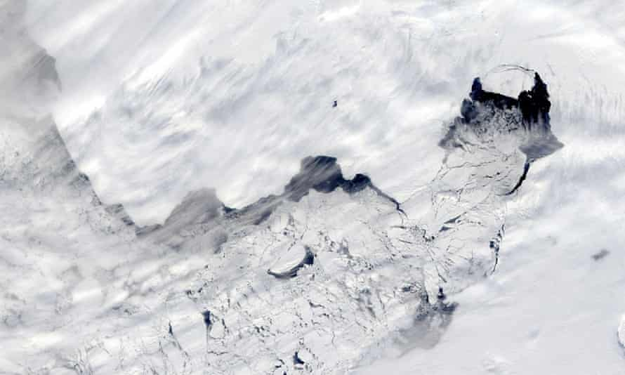 a large iceberg separated from the calving front of Antarctica's Pine Island Glacier