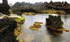 Natural swimming pools carved into the rock at Biscoitos on Terceira island, Azores.