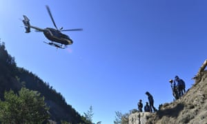 Rescue workers and police continue the search near the site of the Germanwings plane crash near Seyne-les-Alpes, some 1,900 metres up in the French Alps.