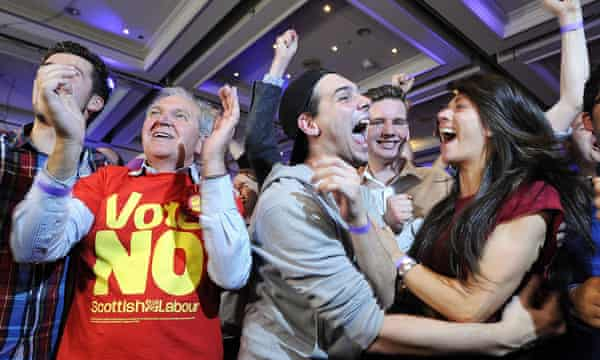 Pro-union supporters celebrate as Scottish independence referendum results are announced at a Better Together event in Glasgow