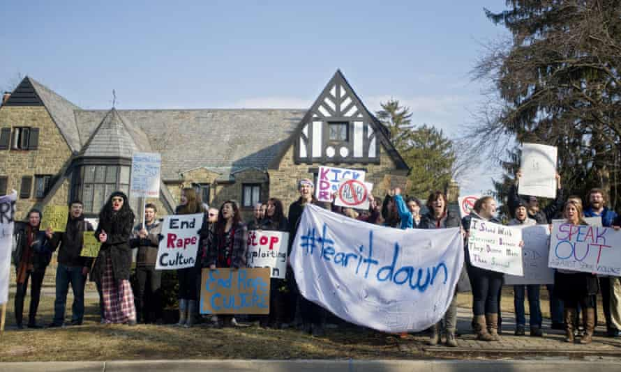 Protesters gather outside the Kappa Delta Rho fraternity house in State College, Pennsylvania.