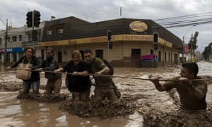 Chilean national police help evacuate people affected by the overflow of the river Copiapo in the city of the same name.