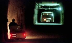 A worker drives a cart through a tunnel inside the Waste Isolation Pilot Plant No. 2, 150 feet below the surface near Carlsbad, New Mexico. Experts  have determined that an incompatible cocktail of nitrate salts and organic cat litter is to blame for a mishap that forced the closure of the nation's only underground nuclear waste repository.