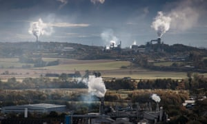 Looking east from Stirling, steam and smoke rise from the factories of the Forth valley.