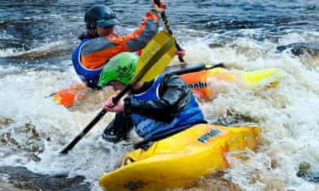 Two people canoeing at the White water centre, at the Tees Barrage during a white water competition.