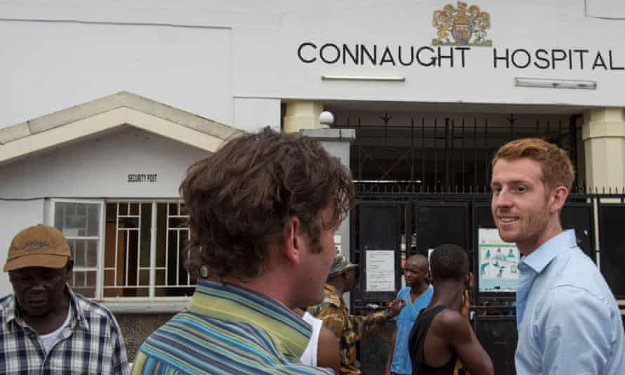 Dr. Colin Brown, chats with Dr. Oliver Johnson, with UK   based King's Health Partner, at right, outside Connaught Hospital in Freetown, Sierra Leone, on Tuesday, November 18, 2014.