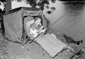 Queens Park Rangers goalkeeper David Seaman settles down for a night-fishing session at Farlows Lake, Iver, Buckinghamshire