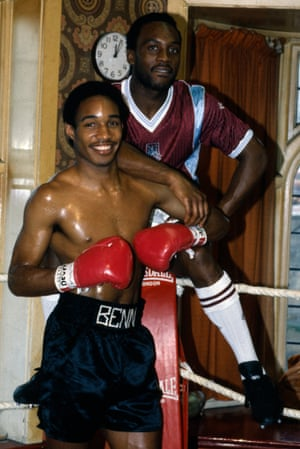 West Ham United's Paul Ince, left, swaps sports with his cousin, Middleweight boxer Nigel Benn