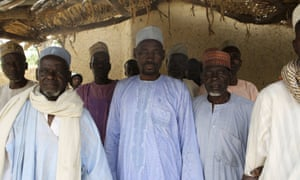 Men who survived Boko Haram occupation of Damasak where 400 women and children were allegedly kidnapped, pose for a picture.