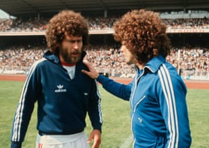Bayern Munich's Paul Breitner, left, and Hamburg's Kevin Keegan discuss the male version of turning up at a party in the same dress