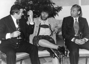 Bayern Munich Chairman Willi O Hoffman, left, with captain Paul Breitner, who didn't get the note about formal dress, and coach Pal Csernai